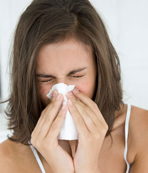 woman hay fever blowing nose